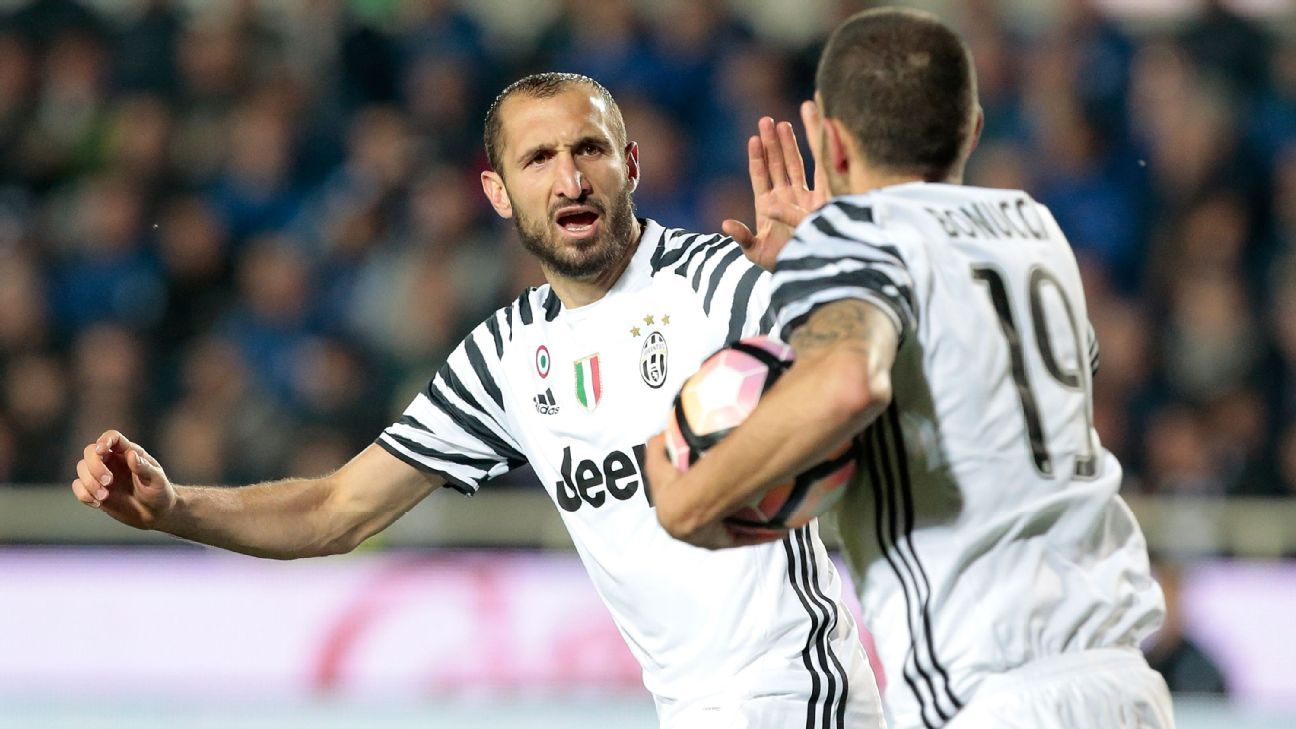 Juventus players Giorgio Chiellini, left, and Leonardo Bonucci celebrate after an Atalanta own goal.