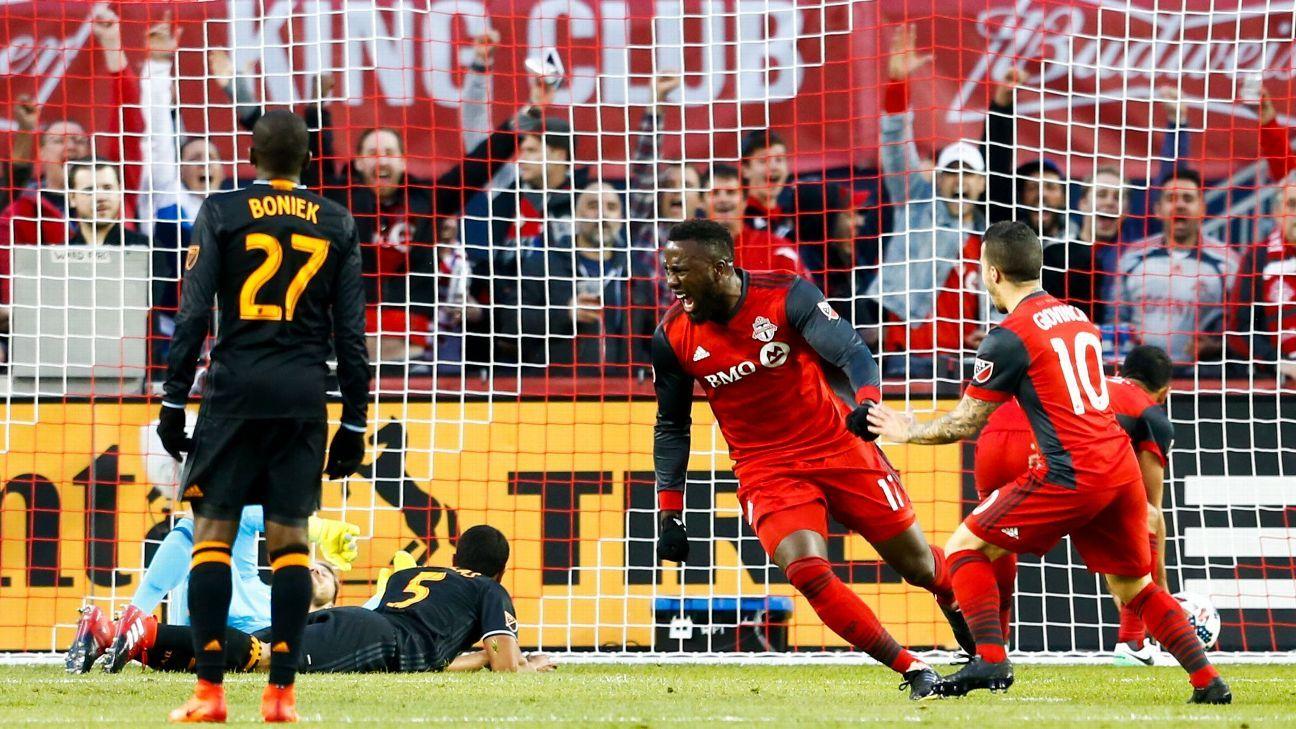 Jozy Altidore, center, celebrates after scoring Toronto FC's second goal against Houston Dynamo.
