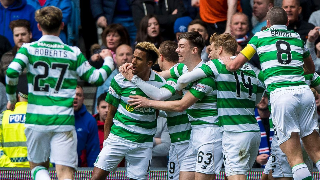 Celtic celebrate as rivals Rangers are thrashed at Ibrox.