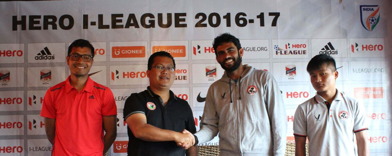 Shillong Lajong coach Thangboi Singto (second from left) with Aizawl FC's Khalid Jamil.