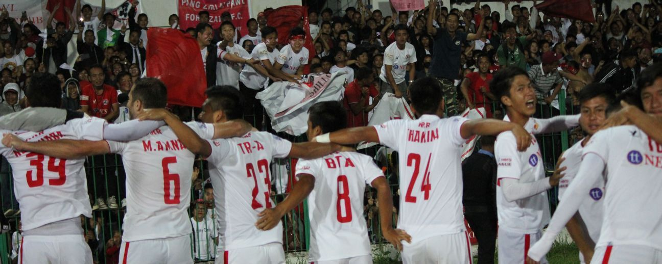 Aizawl players celebrate their I-League triumph following a draw against Shillong.