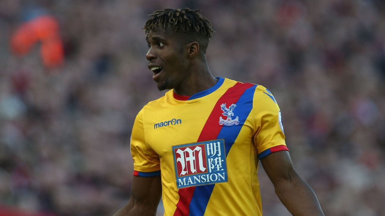 Wilfred Zaha of Crystal Palace disputes a decision of the referee during a Premier League game against Liverpool at Anfield in Liverpool, England on April 23, 2017. (Photo by David Blunsden/Action Plus via Getty Images)