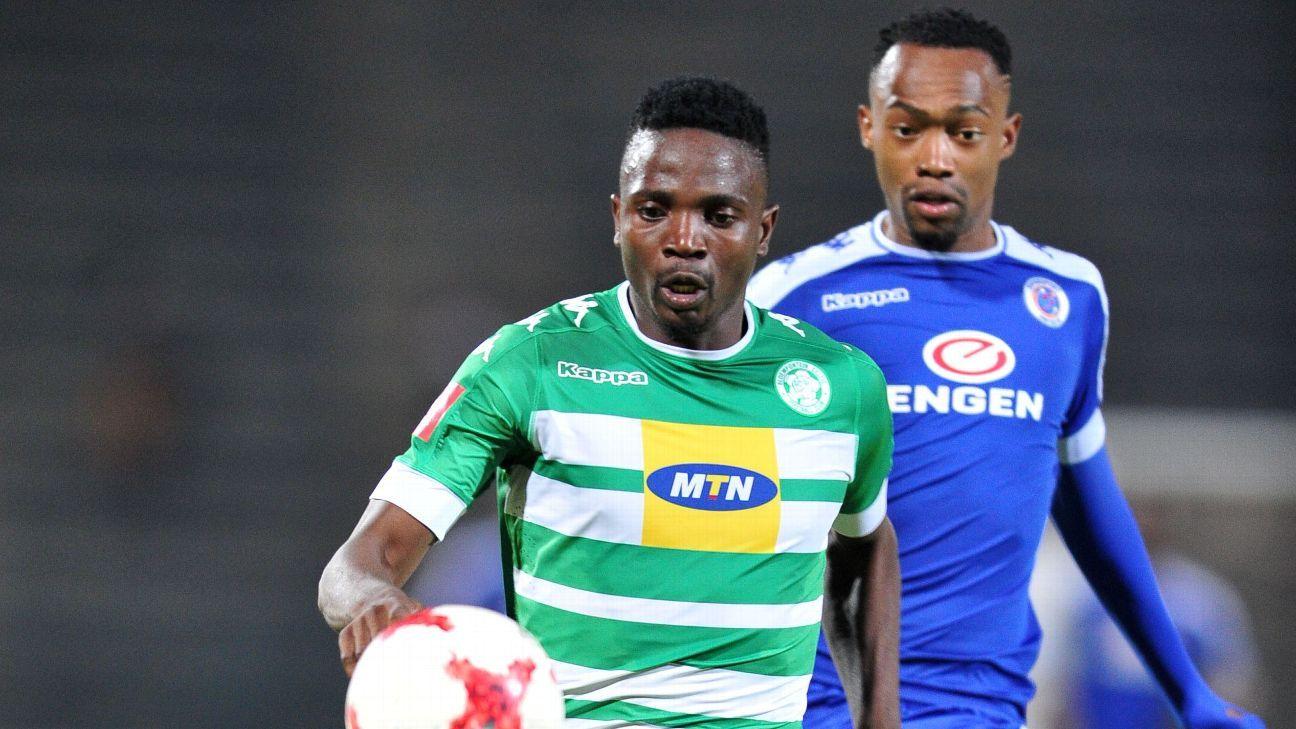 Tshepo Rikhotso of Bloemfontein Celtic challenged by Thabo Mnyamane of SuperSport United