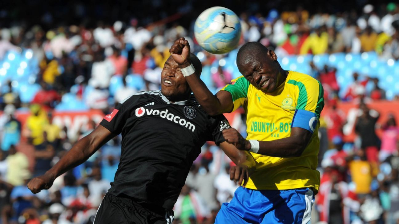 Gift Motupa of Orlando Pirates is challenged by Hlompho Kekana of Mamelodi Sundowns   during Absa Premiership match between Mamelodi Sundowns and Orlando Pirates at Loftus Stadium.