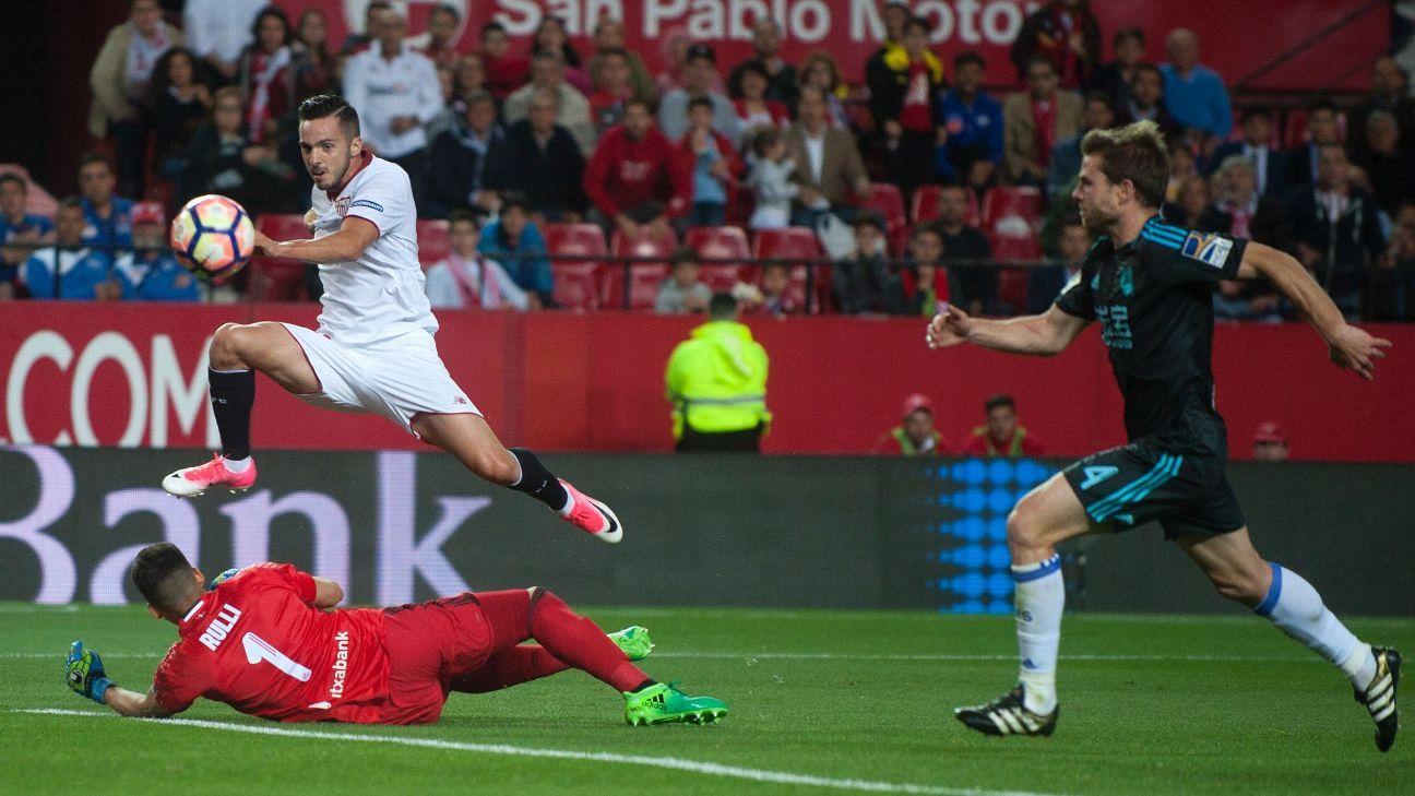 Sevilla's midfielder Pablo Sarabia scores past Real Sociedad's goalkeeper Geronimo Rulli in a La Liga match on Friday.