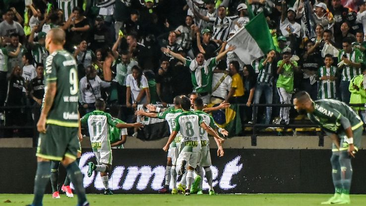 Atletico Nacional players celebrate after scoring a goal against Chapecoense in the Recopa Sudamericana.