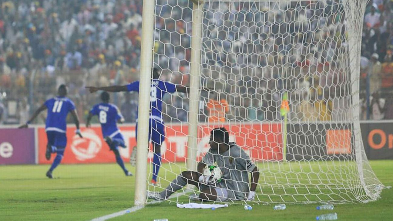 Al Merreikh goalkeeper Jamal Salim picks the ball out of his net after conceding against Al Hilal