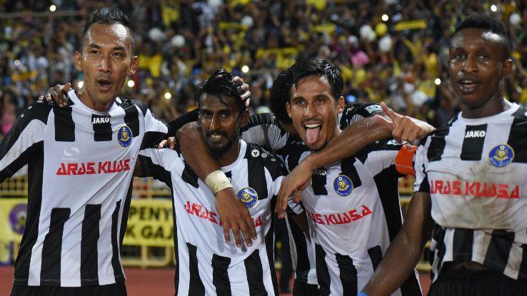 Christie Jayaseelan and Matt Davies celebrate Pahang goal