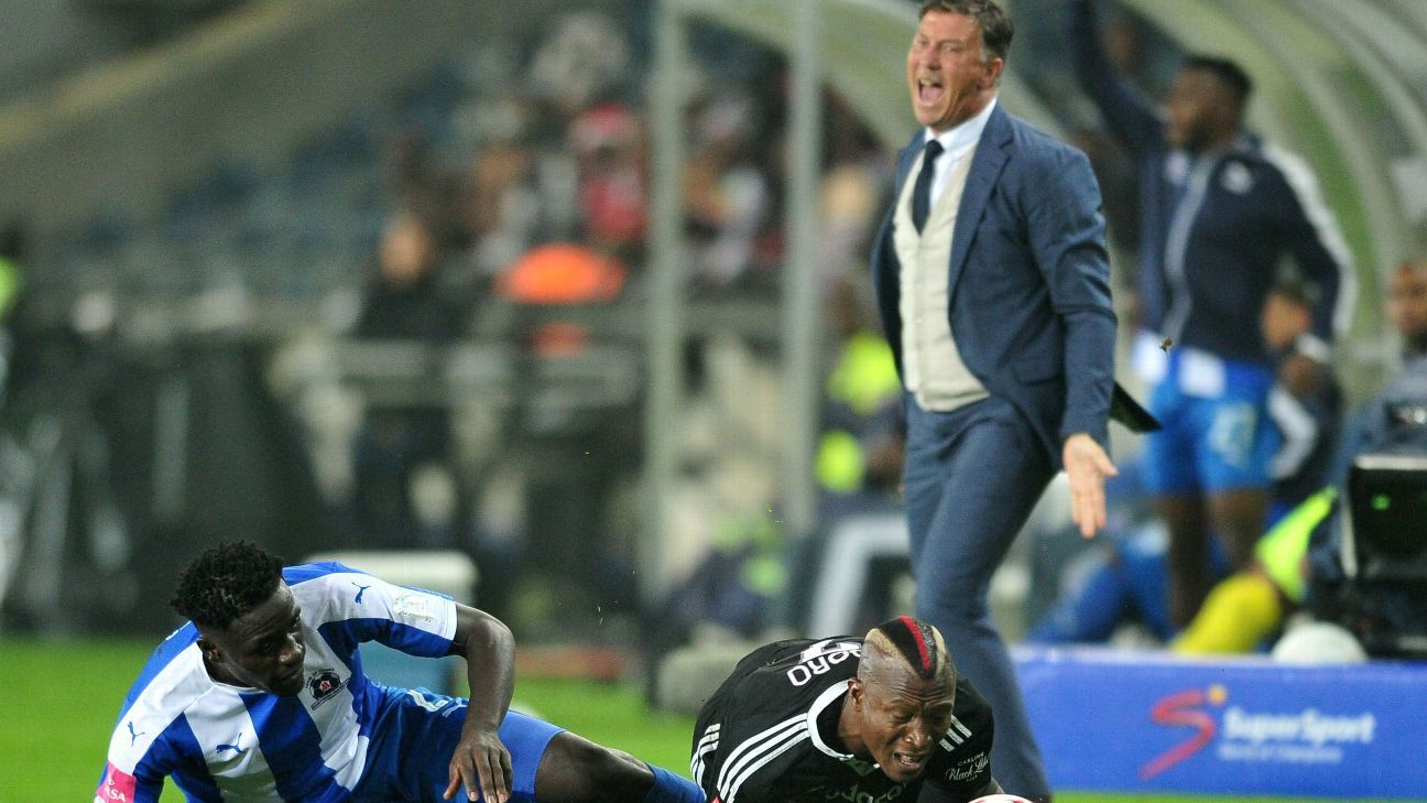 Tendai Ndoro of Orlando Pirates tackled by Brian Onyango of Maritzburg United and Kjell Jonevret, coach of Orlando Pirates reacts during the 2016-17 Absa Premiership match between Orlando Pirates and Maritzburg United at the Orlando Stadium, South Africa