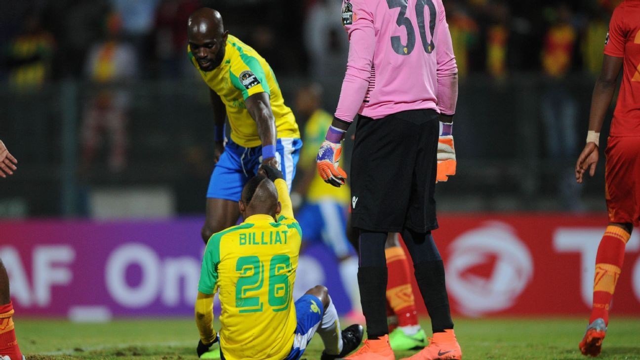 Khama Billiat of Mamelodi Sundowns is helped up by teammate Anthony Laffor of Mamelodi Sundowns during the CAF Champions League match between Mamelodi Sundowns and St George on 13 May 2017 at Lucas Moripe Stadium, Pretoria South Africa.
