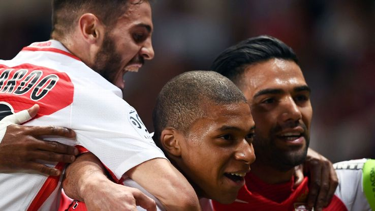 Monaco players celebrate after Kylian Mbappe scored a goal in a win against St Etienne.