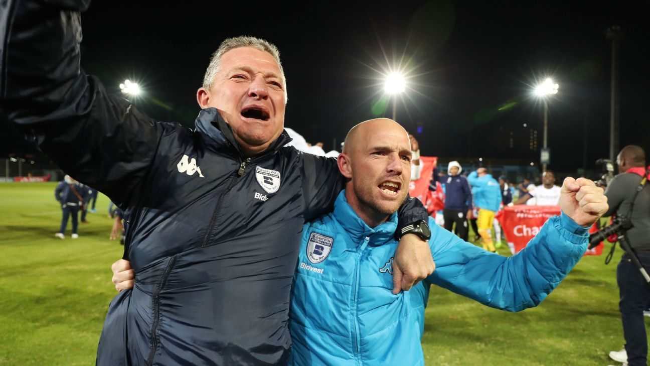 Gavin Hunt (L) and Paul Johnstone (assistant coach) celebrate as Bidvest Wits' title win.