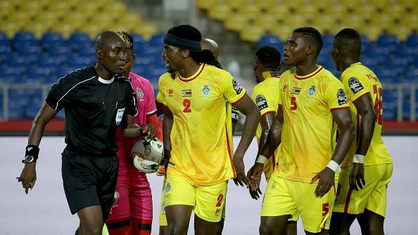 Football players of Zimbabwe talk with the referee of the match after his penalty decision during the 2017 Africa Cup of Nations group B football match between Zimbabwe and Tunisia in Libreville.