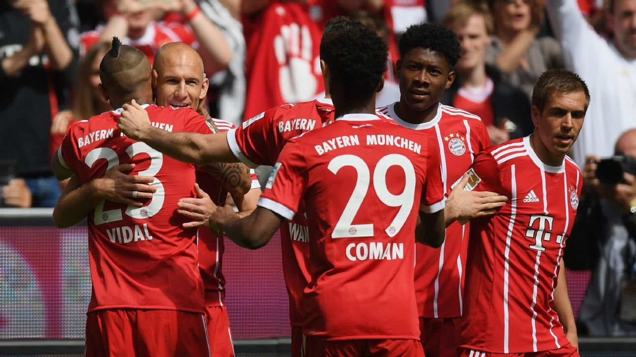 Arjen Robben is congratulated by Bayern Munich teammates after scoring against Freiburg.