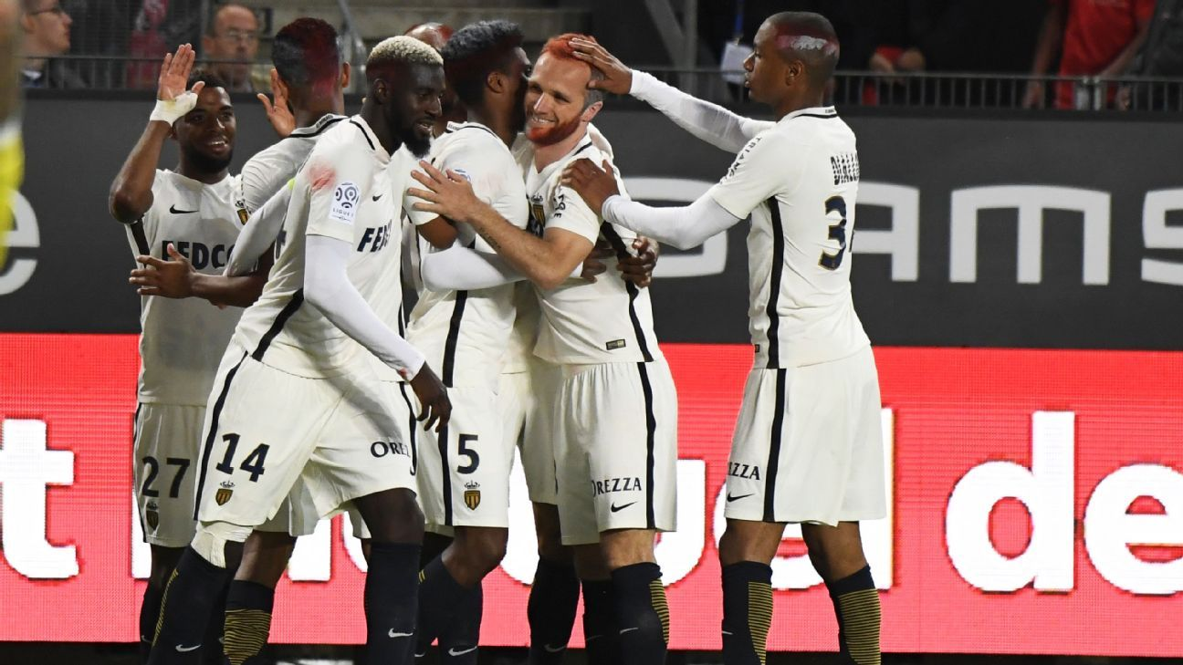 Monaco players celebrate after Fabinho scored a goal in a 3-2 win against Rennes.