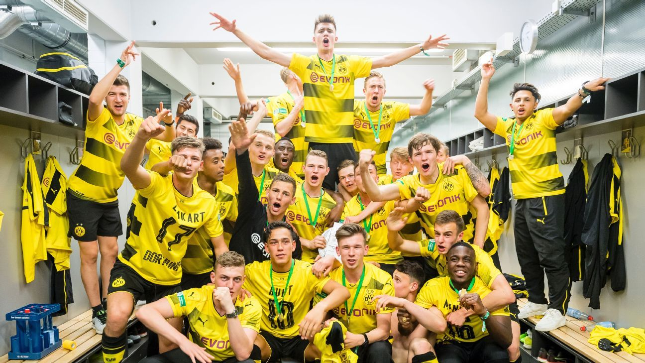 Borussia Dortmund under-19s celebrate beating Bayern Munich on penalties to win the championship for a fourth consecutive time.