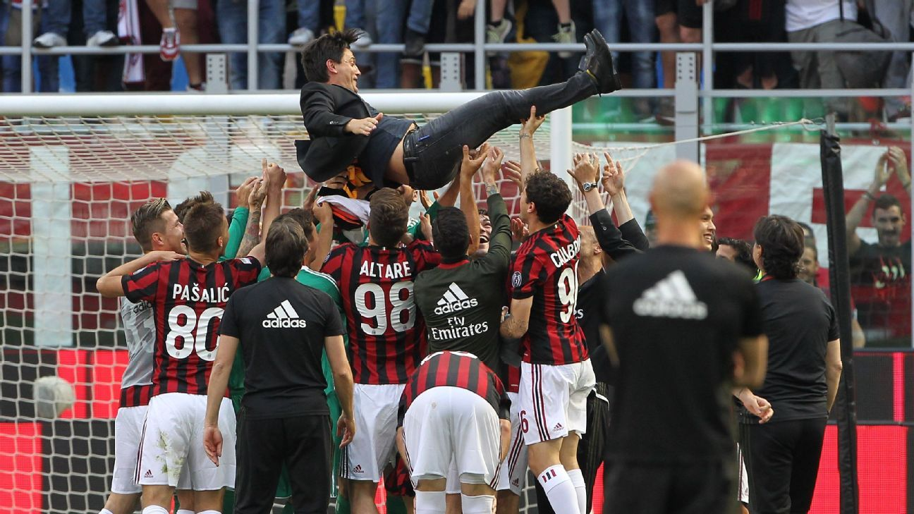 Vincenzo Montella and AC Milan celebrate the club's qualification for the Europa League following the Serie A victory against Bologna.