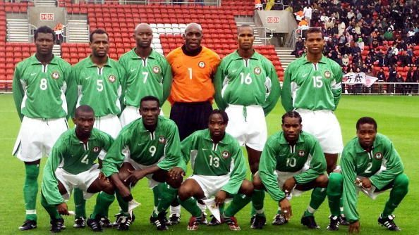 Nigerian national soccer team players pose for a group picture 07 October 2001 in Southampton before the start of their friendly match against Japan in preparation for the upcoming 2002 FIFA World Cup Korea/Japan.
