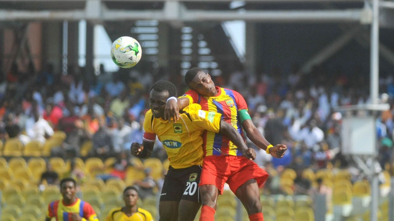 Thomas Abbey of Accra Hearts of Oak challenging Amos Frimpong of Kumasi Asante Kotoko during the Ghana Premier League week day 8.