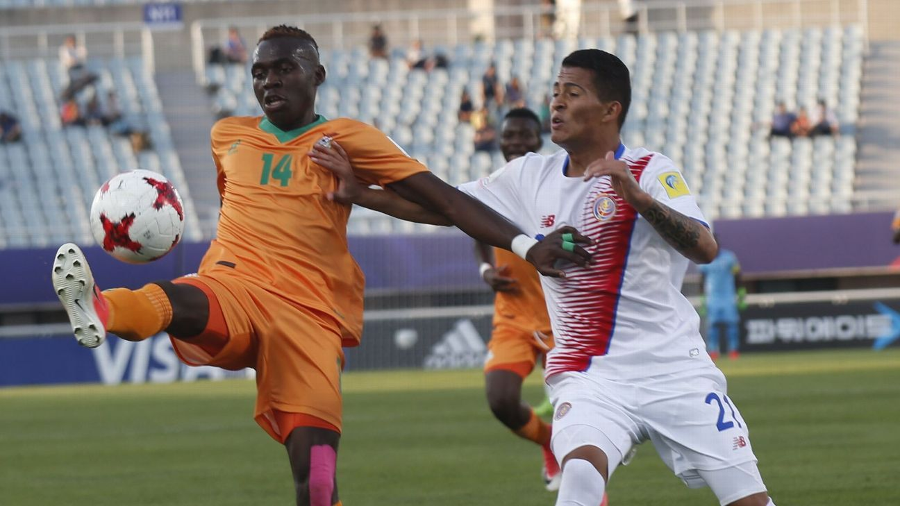 Edward Chilufya of Zambia vies for the ball with Yostin Salinas of Costa Rica during FIFA Under-20 World Cup match.