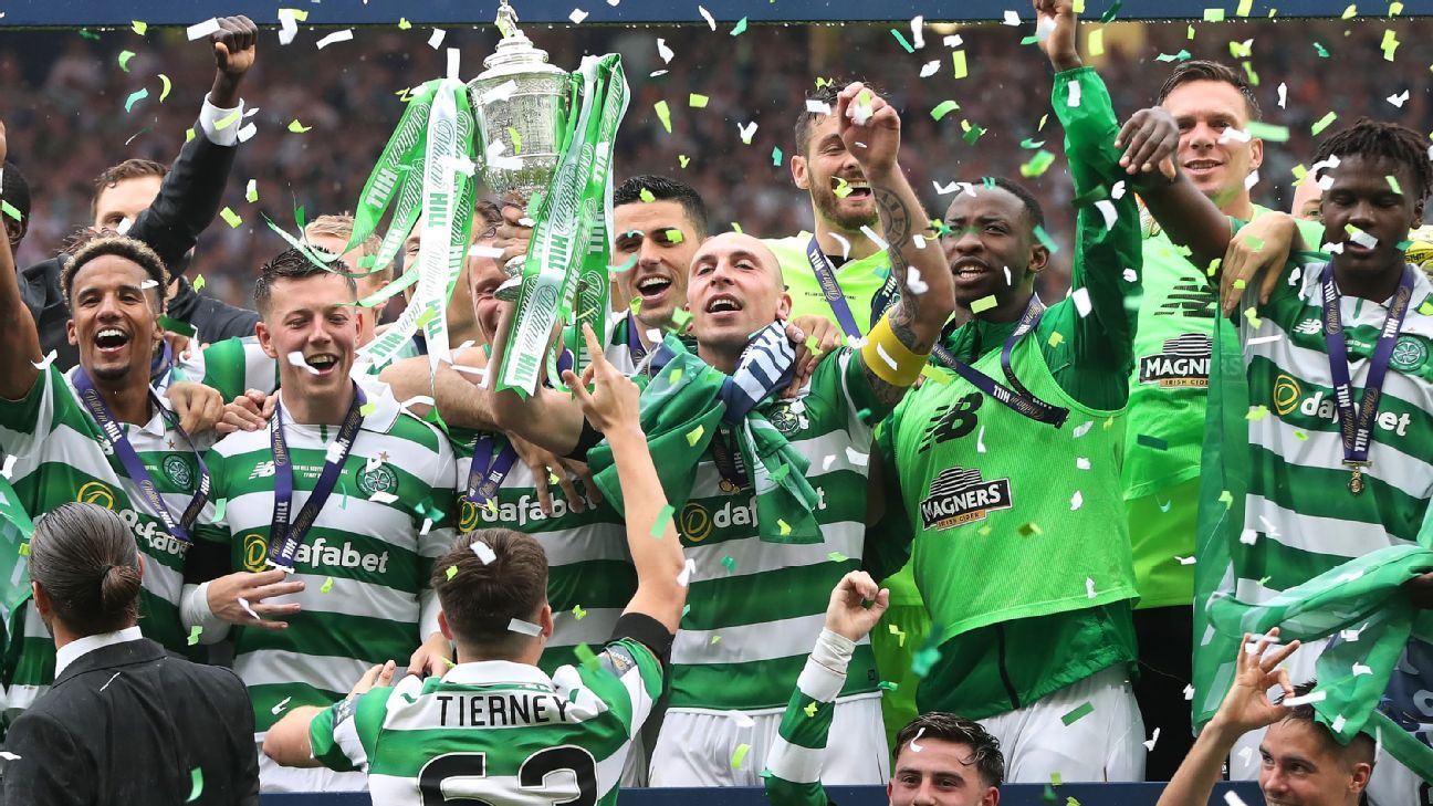 Scott Brown lifts the Scottish Cup after Celtic had beaten Aberdeen at Hampden Park.