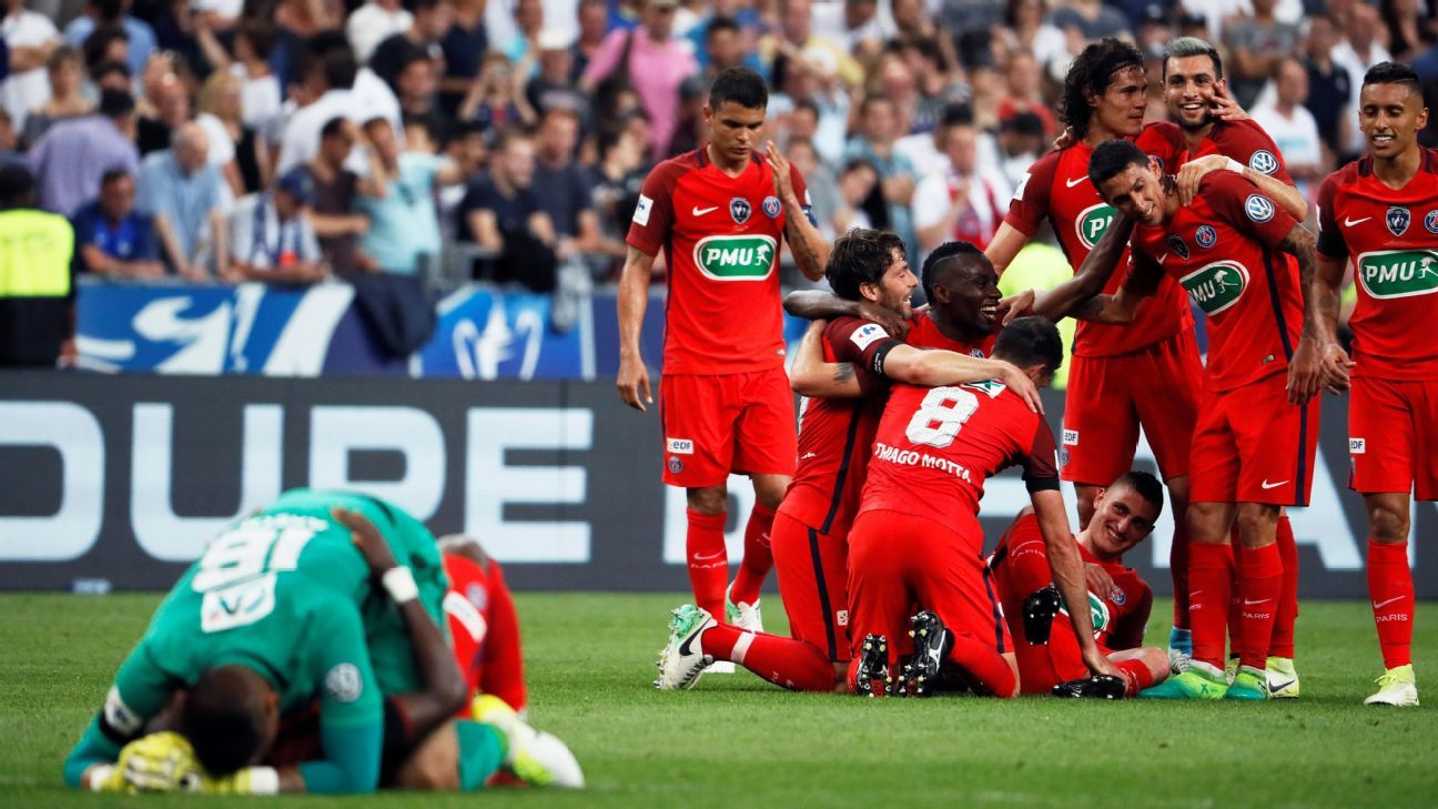 PSG players celebrate after a late own goal from Angers gifted them a Coupe de France win.