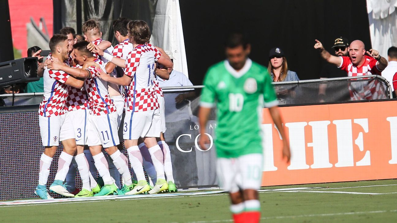 Croatia players celebrate after opening the scoring in a friendly against Mexico.