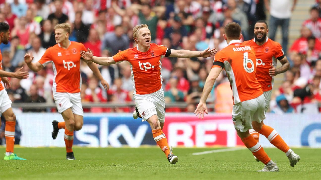 Blackpool celebrate Mark Cullen's winner.