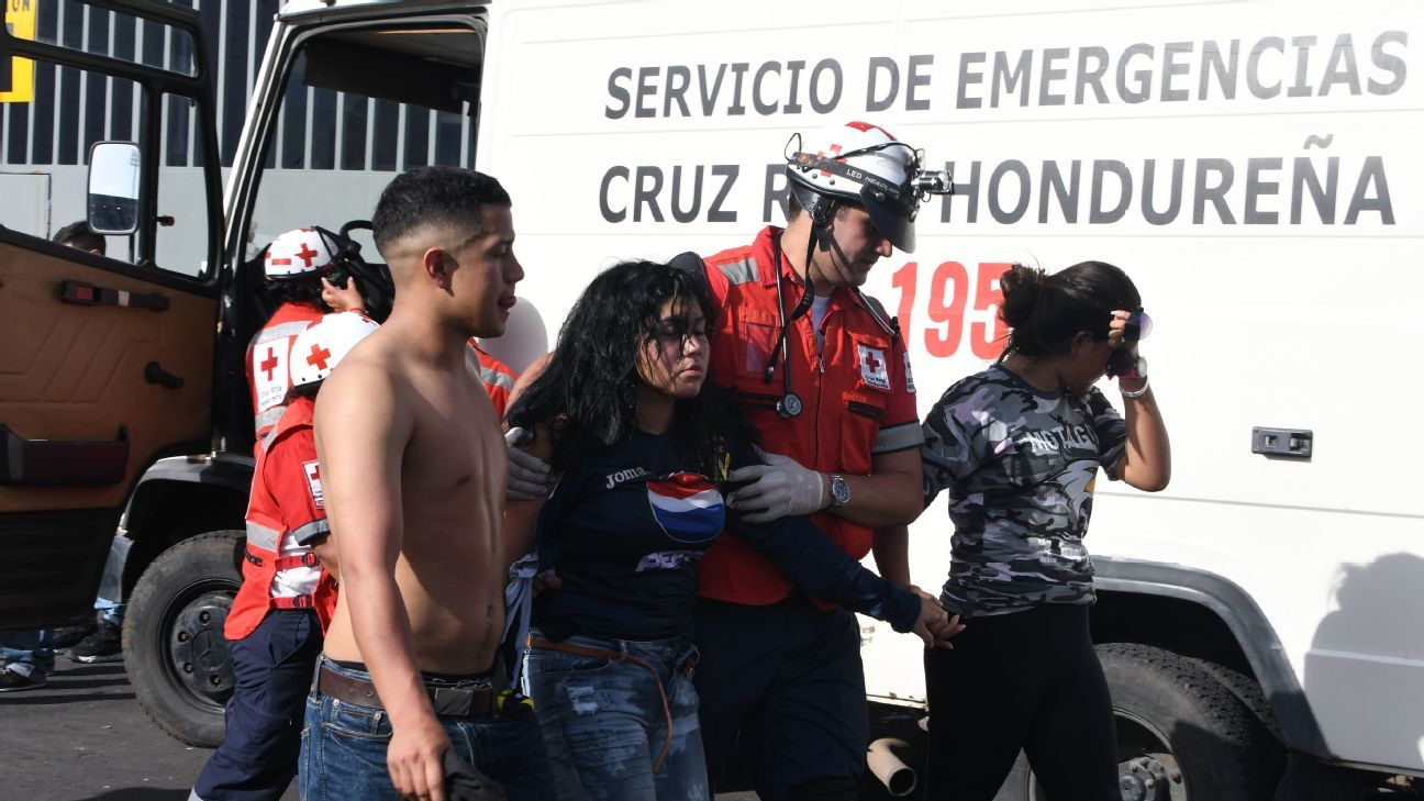 Members of the Red Cross assist an injured fan after the stampede at the National Stadium in Tegucigalpa.