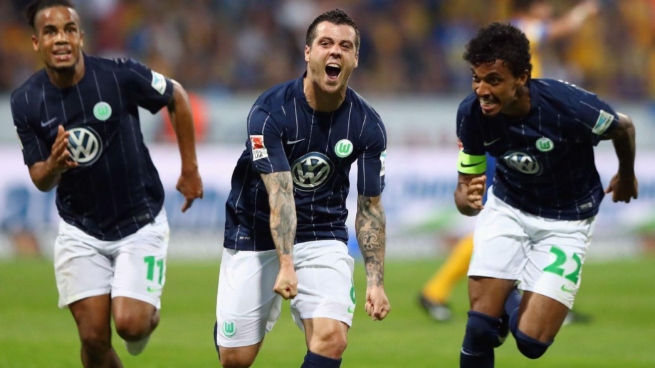 Vieirinha celebrates his goal in Wolfsburg's relegation playoff triumph on Monday.