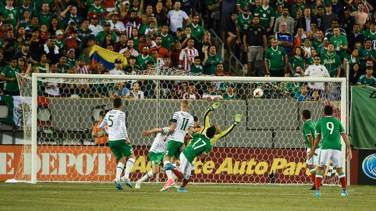 Jesus Corona of Mexico scores his team's first in a friendly win against Ireland.