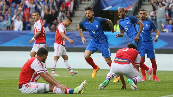 Olivier Giroud celebrates after opening the scoring for France in a friendly win against Paraguay.