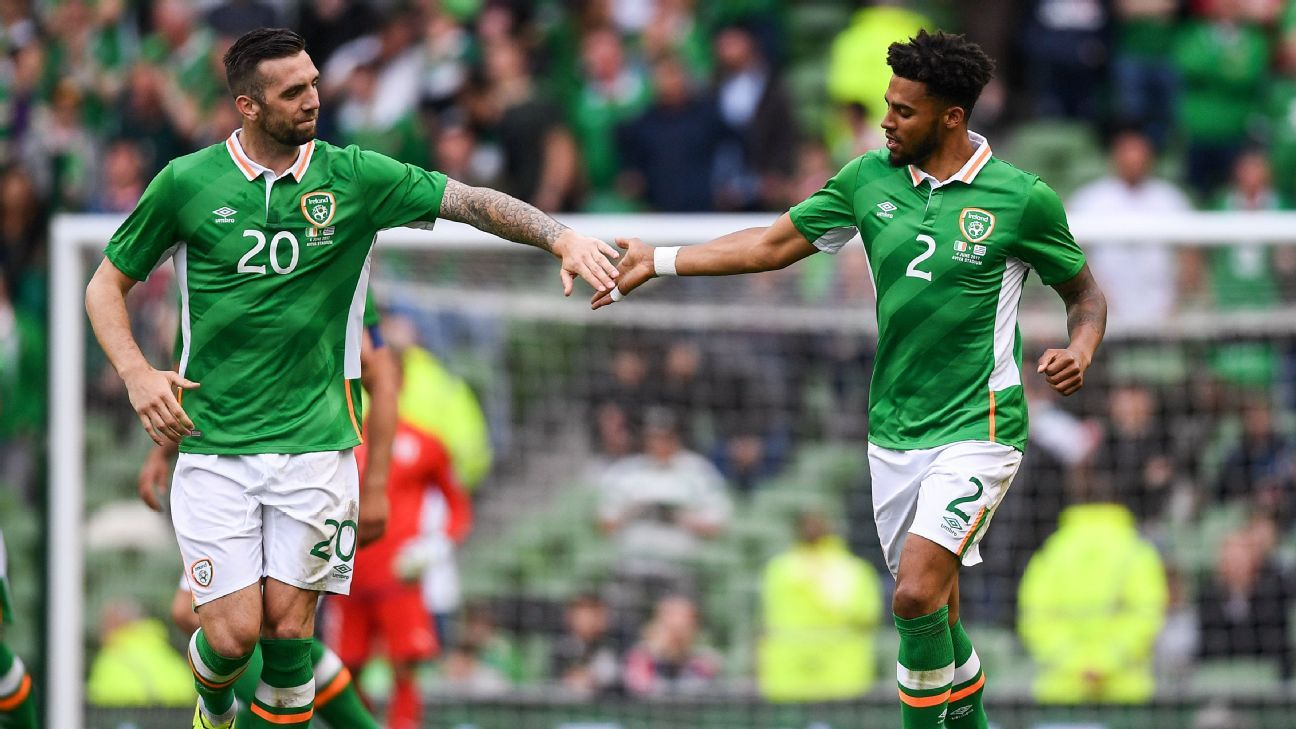 Cyrus Christie of the Republic of Ireland celebrates with Shane Duffy after scoring a goal for his team against Uruguay.