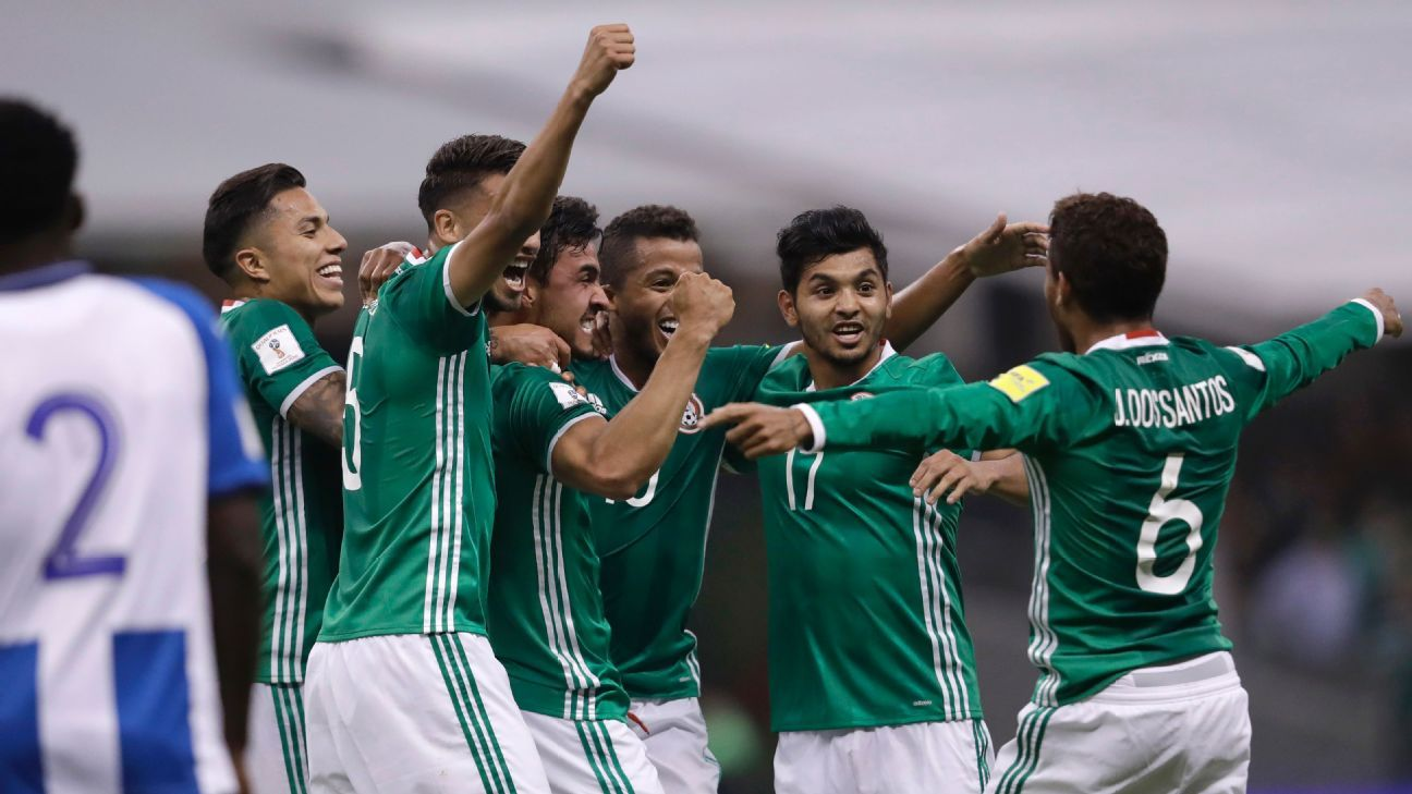 Mexico players celebrate after scoring a goal against Honduras in World Cup qualifying.