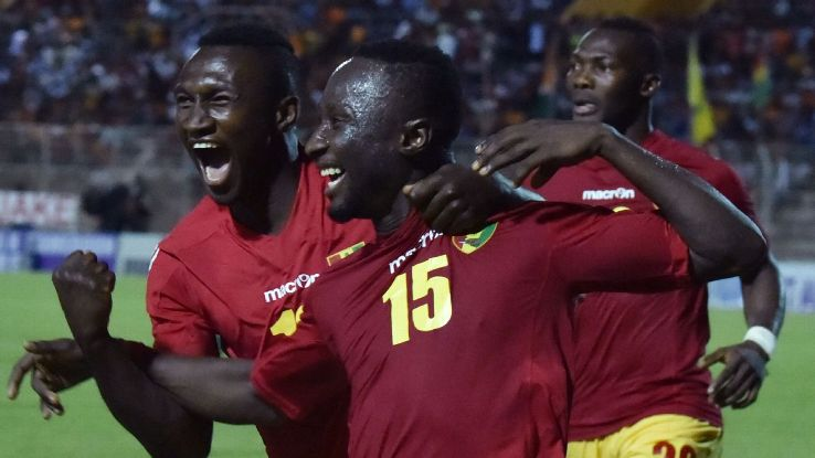Guinea players celebrate a goal against Ivory Coast