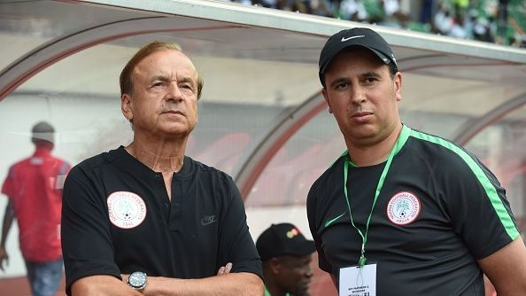 Head Coach of Nigerian national football team Gernot Rohr (L) flanked by an assistant looks on during the 2019 African Cup of Nations qualifyer football match against South Africa at the Goodswill Akpabio International Stadium.