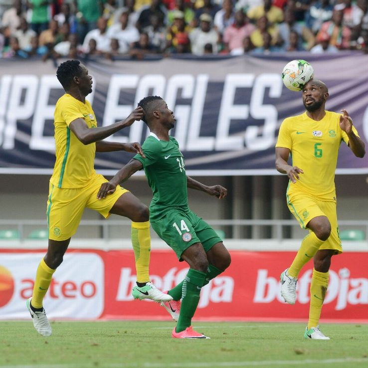 Kelechi Iheanacho of Nigeria is boxed out by South African defenders.