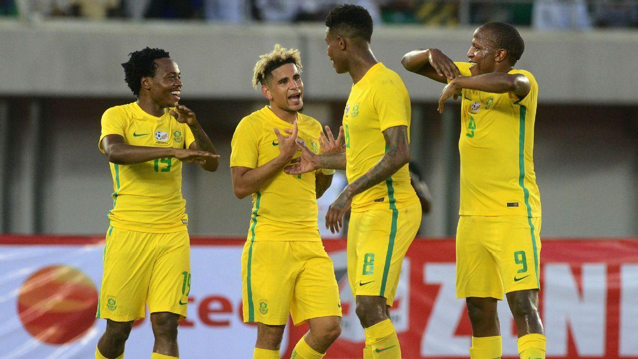 Percy Tau of South Africa celebrates a goal with Keagan Dolly, Bongani Zungu and Lebogang Manyama