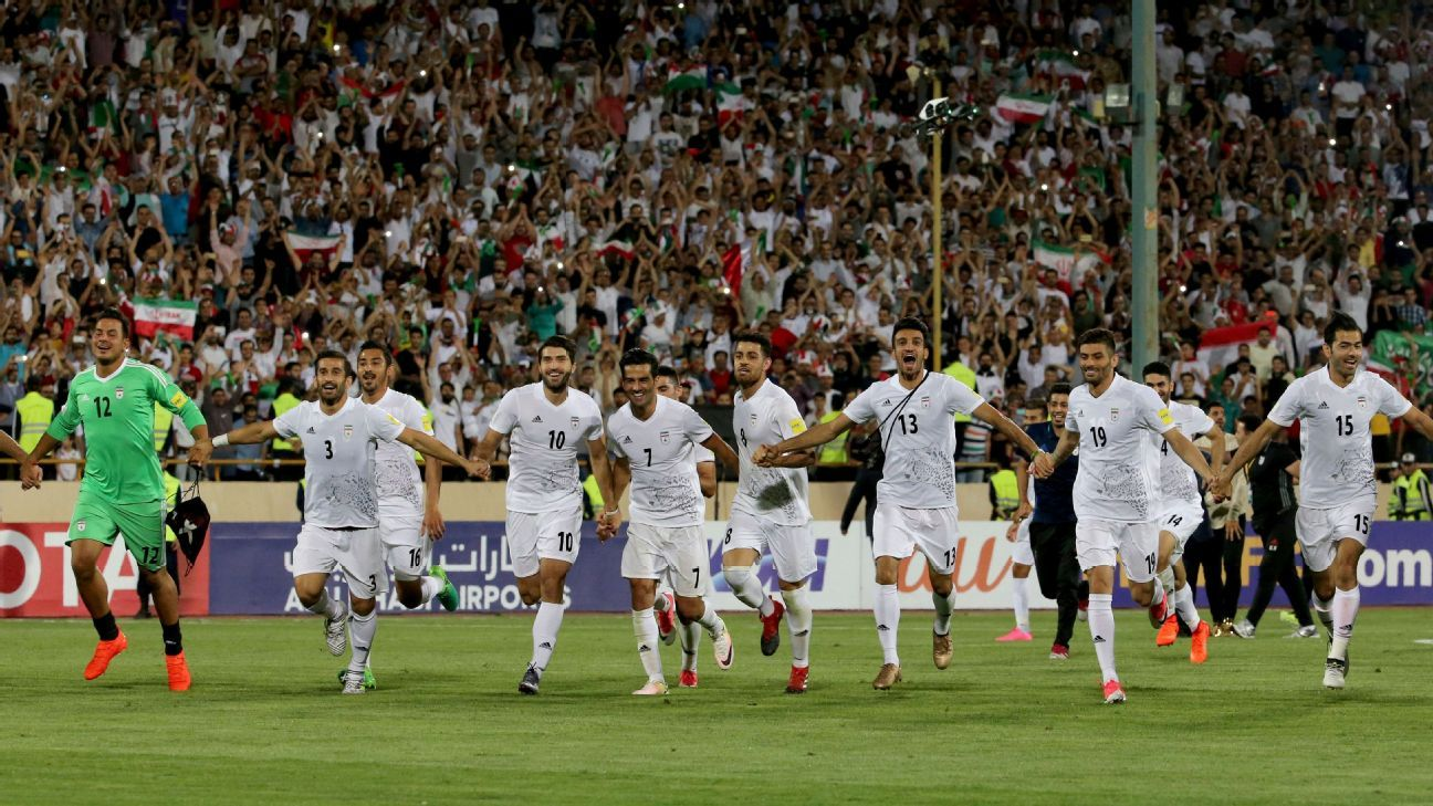 Iran celebrate after qualifying for their second straight World Cup.