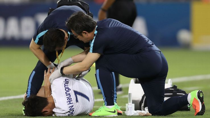 Son Heung-Min receives medical treatment during South Korea's World Cup qualifying match against Qatar.