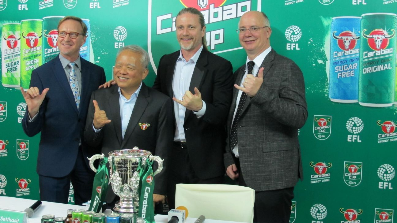 Emmanuel Petit and officials at EFL Cup draw in Bangkok