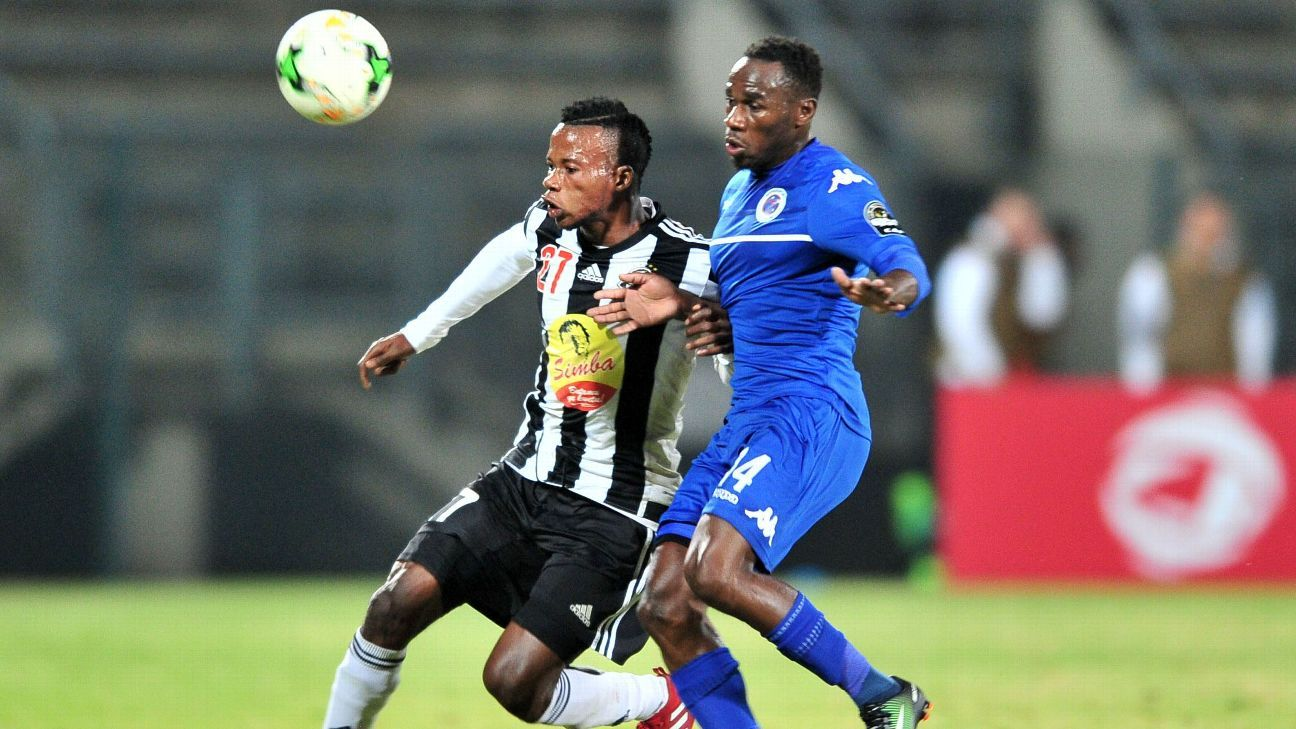 Ben Ngita of TP Mazembe challenged by Onismor Bhasera of Supersport United