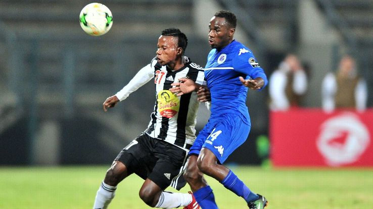 Ben Ngita of TP Mazembe challenged by Onismor Bhasera of Supersport United
