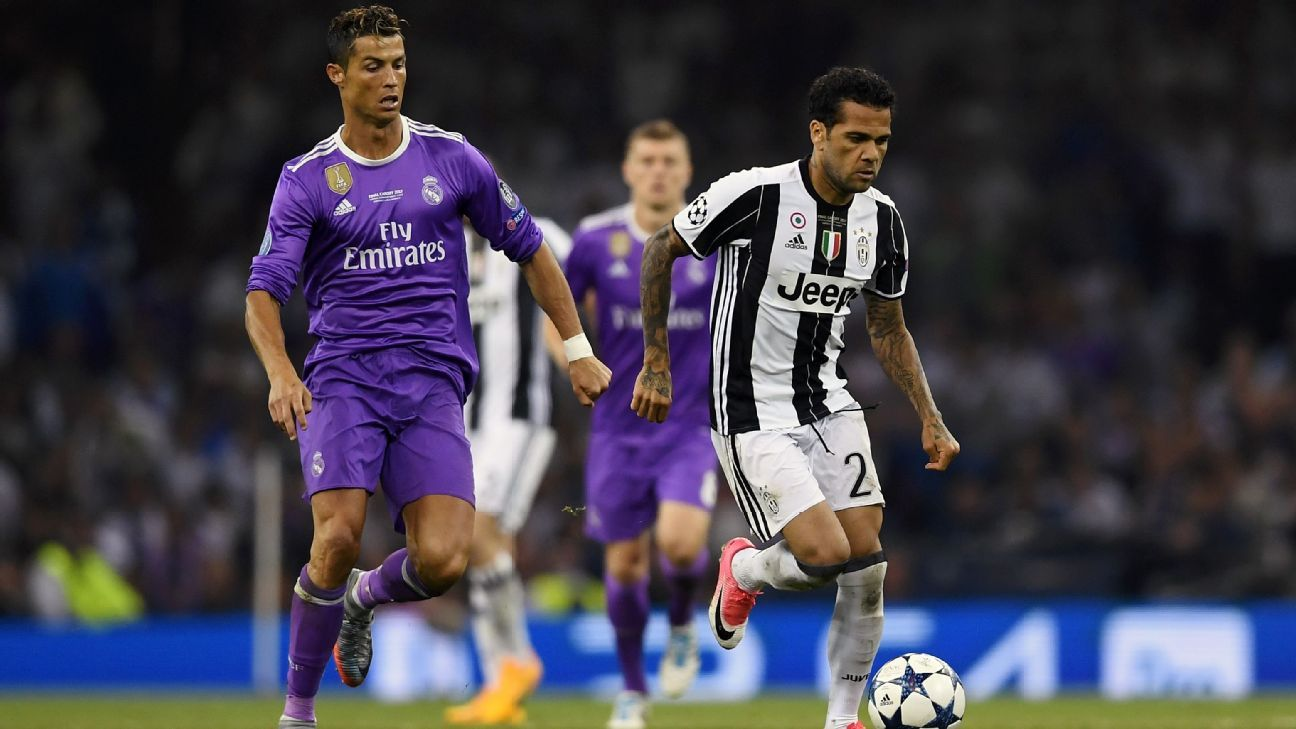 Dani Alves of Juventus and Cristiano Ronaldo of Real Madrid battle for possession