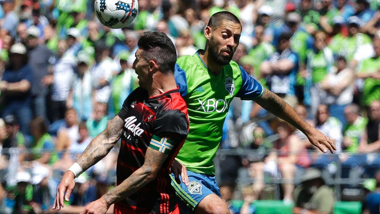 Liam Ridgewell and Clint Dempsey