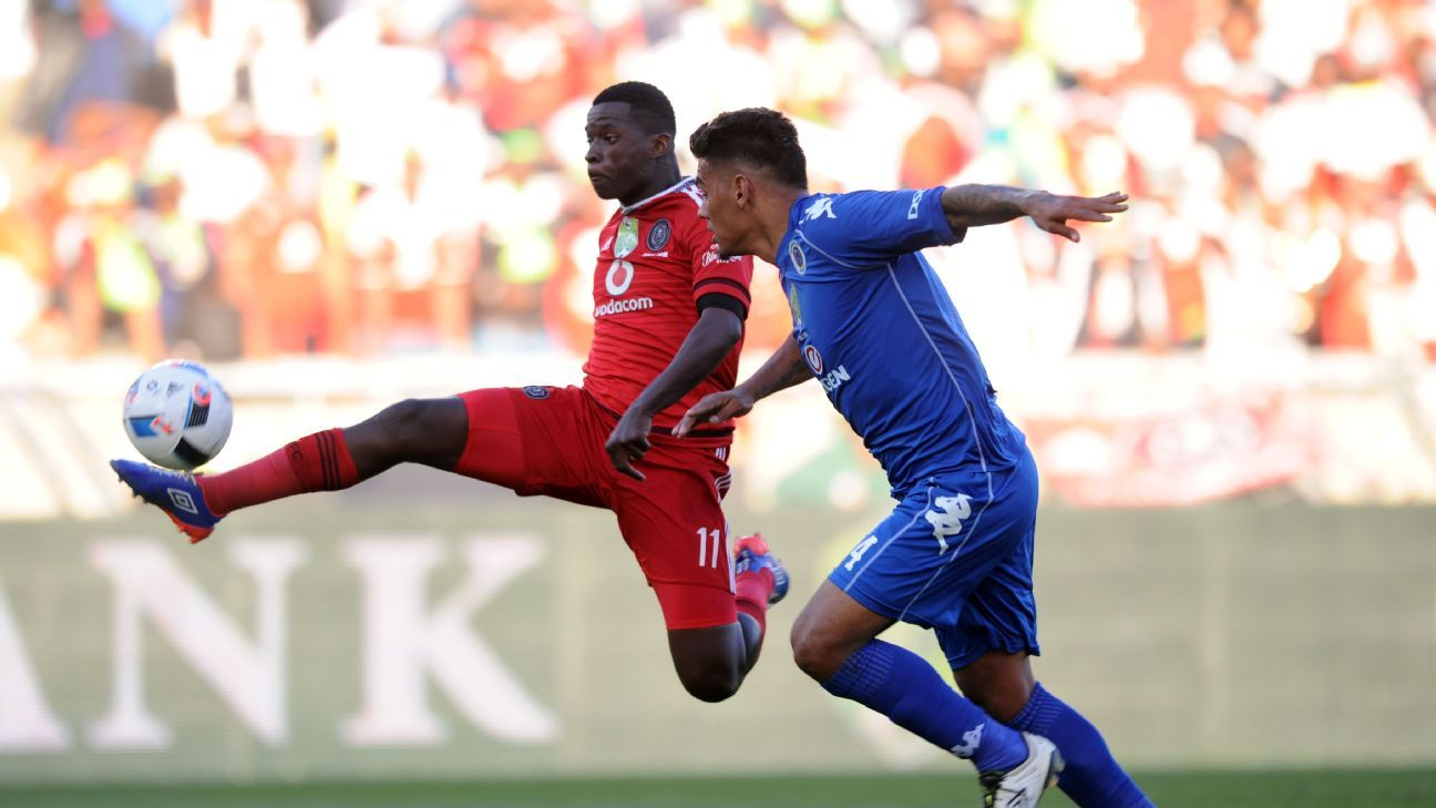Clayton Daniels  of Supersport United challenges Sifiso Myeni of Orlando Pirates  during the Nedbank Cup Final match between Supersport United and Orlando Pirates  on 28 May 2016 at Peter Mokaba Stadium.