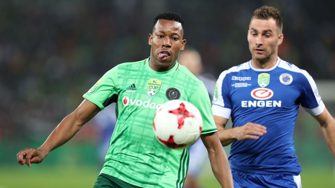 Happy Jele of Orlando Pirates is challenged by Bradley Grobler of Supersport United during the 2017 Nedbank Cup final in Durban.