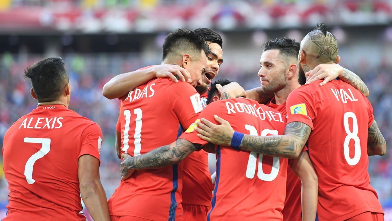 Chile celebrate their equaliser against Australia.