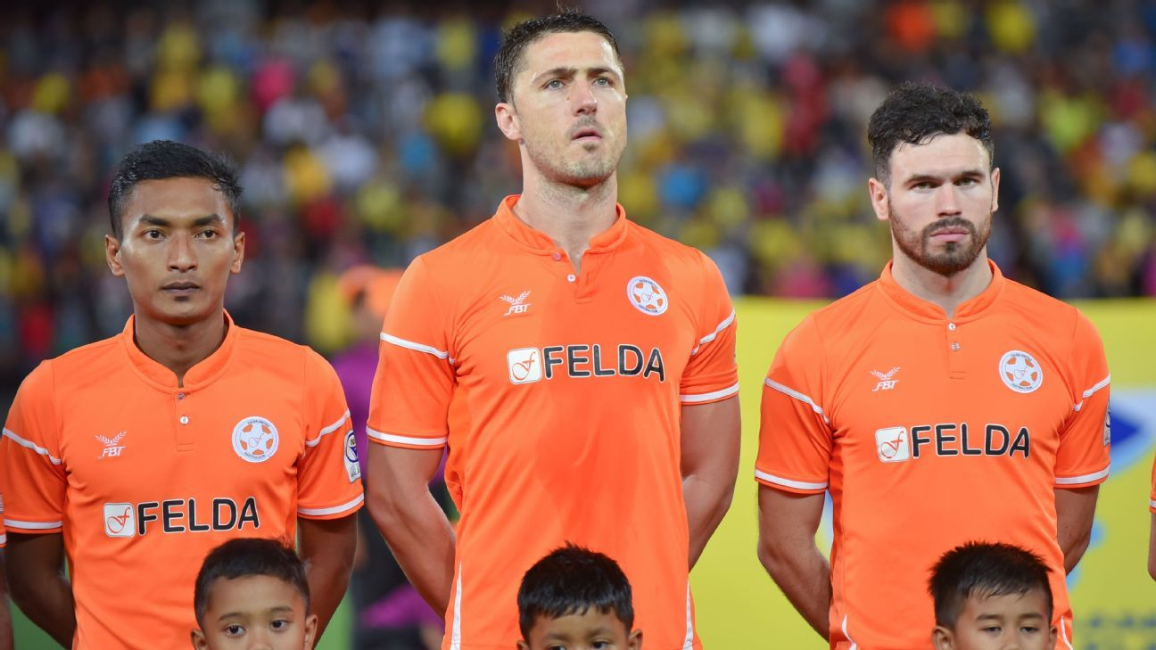Felda United players Dino Djulbic and Stuart Wark