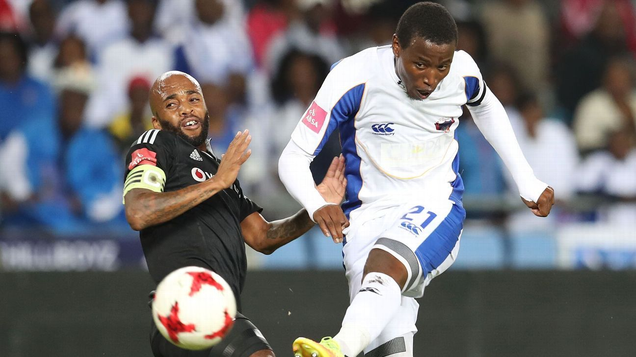 Thamsanqa Sangweni of Chippa United is challenged by Oupa Manyisa of Orlando Pirates